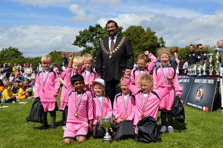 Photo of BSCS Primary Phase football team with town mayor Cllr Tom Aditya.