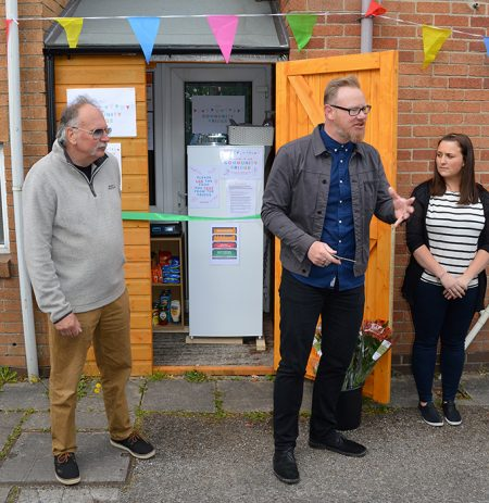 Photo of the official opening of the community fridge at Cafe Church.