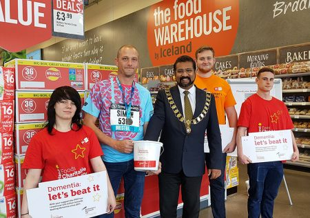 Photo of Bradley Stoke mayor Tom Aditya with Food Warehouse staff.