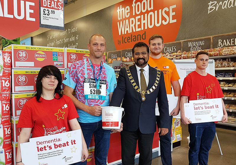 Photo of Bradley Stoke mayor Tom Aditya with Food Warehouse staff.