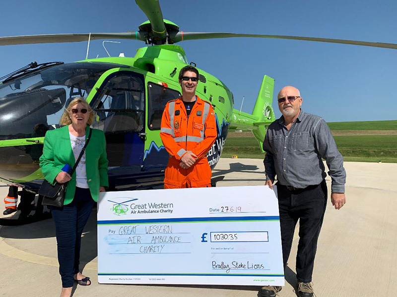 Photo of representatives of Bradley Stoke Lions Club presenting a cheque to a member of the air ambulance team.