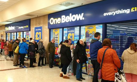 Photo of shoppers queuing outside a One Below store.