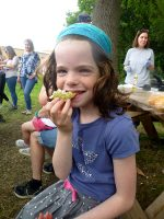 Photo of a girl enjoying the fruits of the foraging walk.