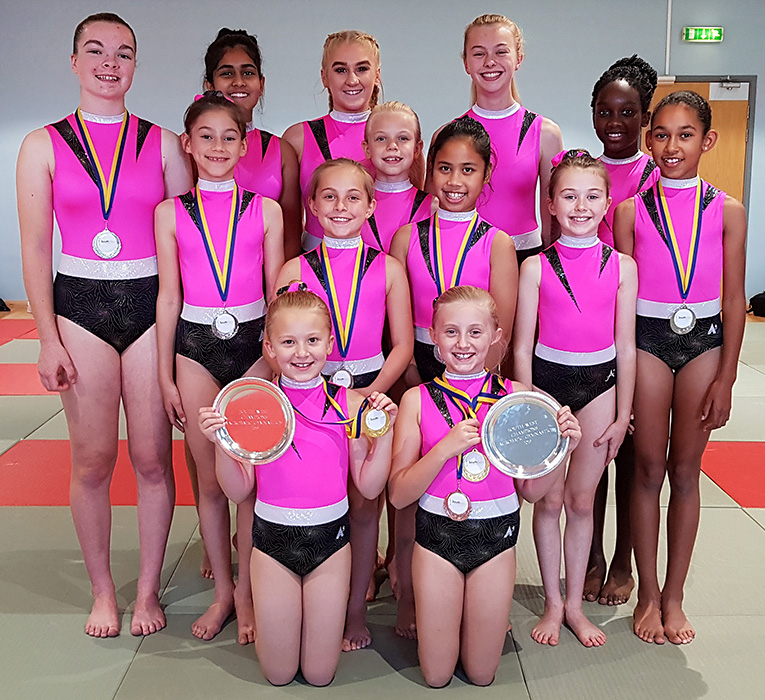Photo of club members with medals and trophies won at the 2019 South West Championships.