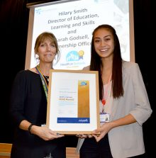 Photo of Jemina Paramore accepting the 'Health in Schools' Gold Award from Sarah Godsell.