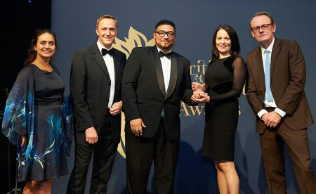 Photo of Natasha Miller (left), Matthew Dobbins (2nd from left) and Lisa White (2nd from right) receiving the award, in the presence of TV comedian Sean Lock (right).