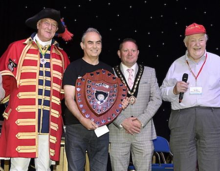 Photo of the Issigonis Shield being presented to Steve Briancourt.
