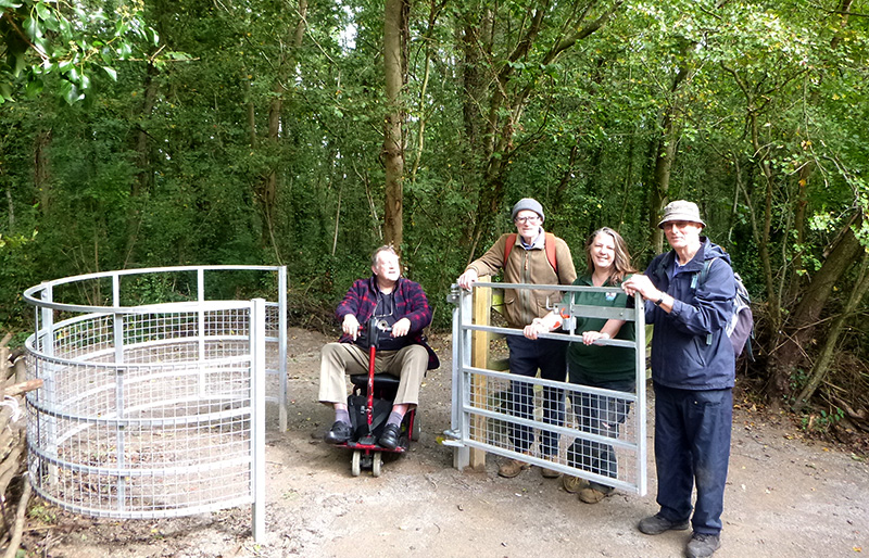 Photo of volunteers standing by the newly constructed disabled access gate into Savages Wood.
