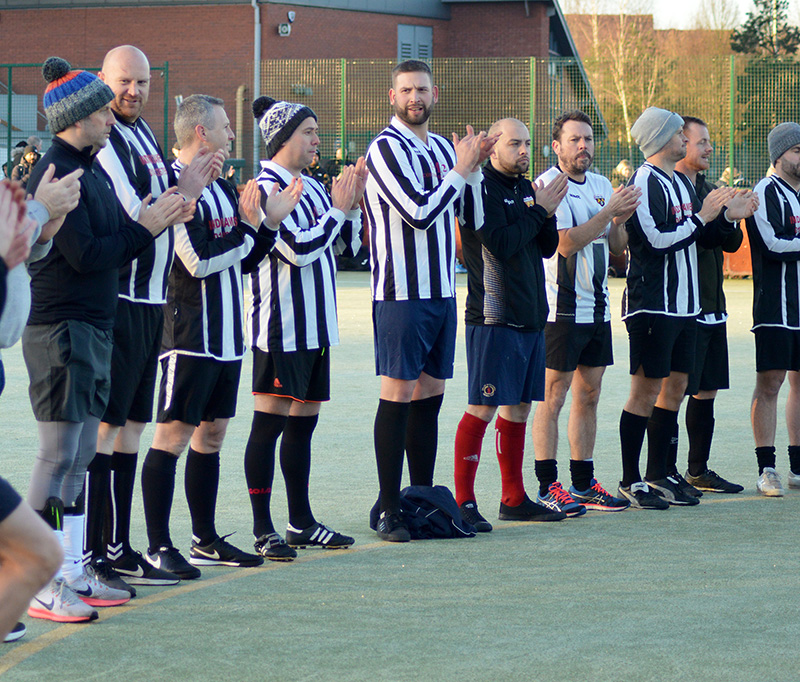 Photo: Players in the Patchway Town FC XI clapping.