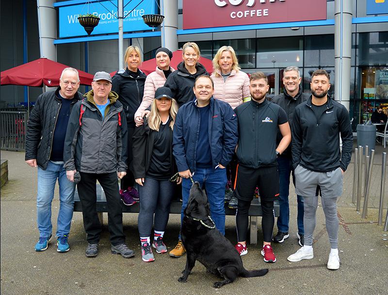 Photo of Matt Baggott (centre, with dog) and friends.