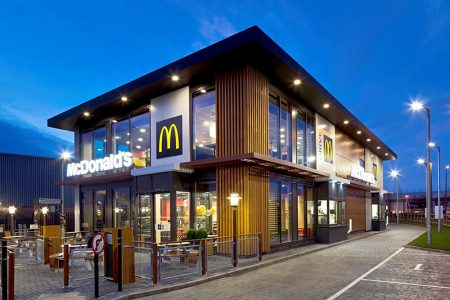 Photo of a typical of two-storey McDonald's restaurant with drive-through.