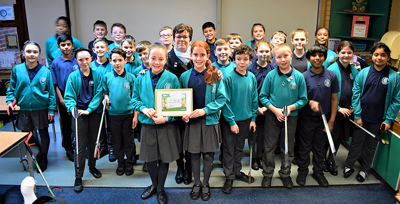 Photo of Cllr Erica Williams presenting winner's certificates to the pupils.