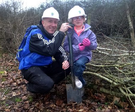 Photo of a young volunteer on the hedgelaying weekend.