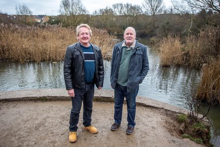 Photo of Cllrs John Ashe (left) and Roger Avenin at the lake.
