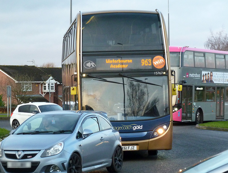 Photo of a 963 Winterbourne Academy school bus service vehicle stuck in traffic congestion at Great Meadow Roundabout.