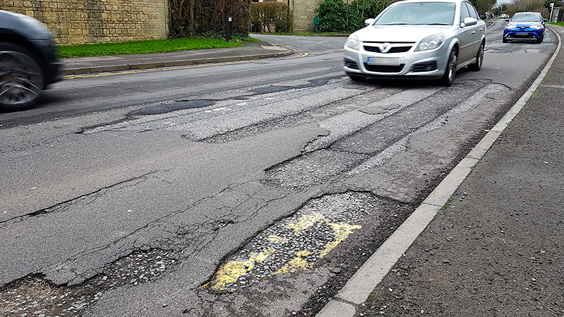 photo of potholes on Woodlands Lane.