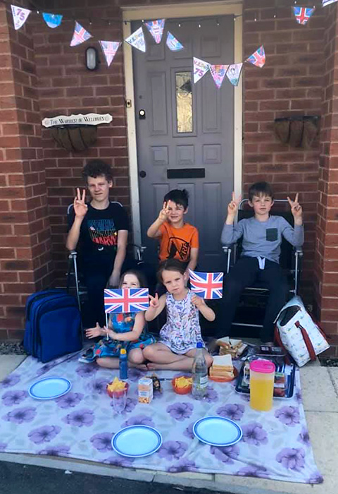 Photo of a doorstep VE Day party.