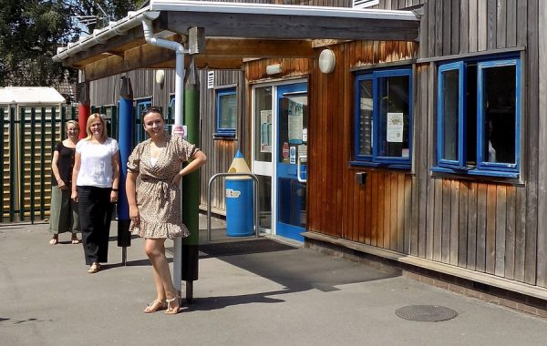 Photo of staff standing outside the front of Brght Sparks Pre-School in Stoke Lodge.