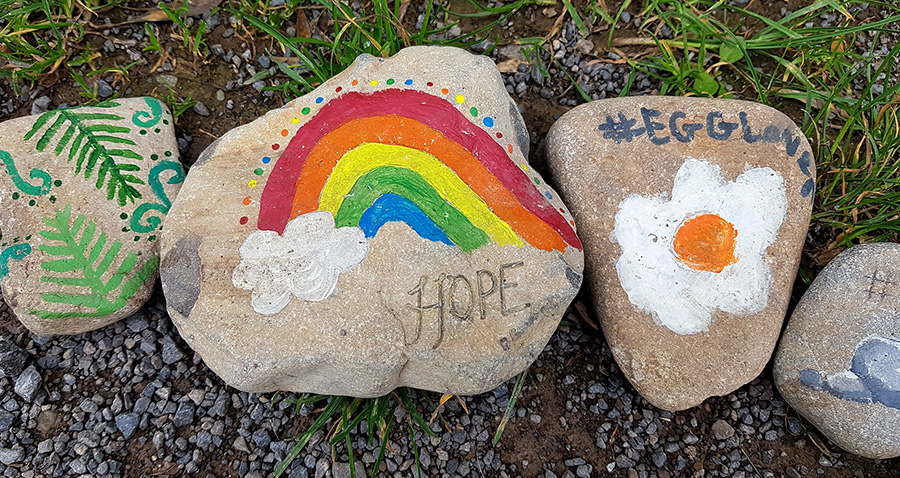 Photo showing three colourfully painted stones in the body of the 'happiness snake'.