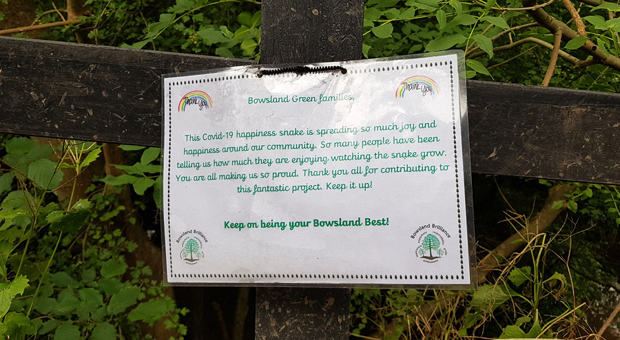 Photo of a notice posted near the 'happiness snake'.