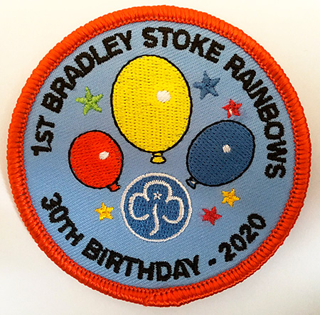 Photo of a 30th birthday badge.
