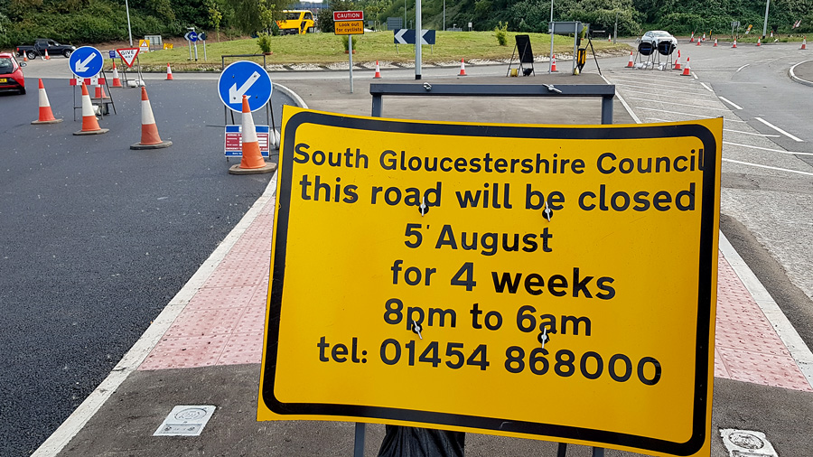 Photo of signage informing of a planned road closure.