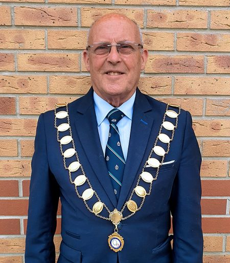 Photo of Cllr Tony Griffiths wearing the mayoral chain of office.