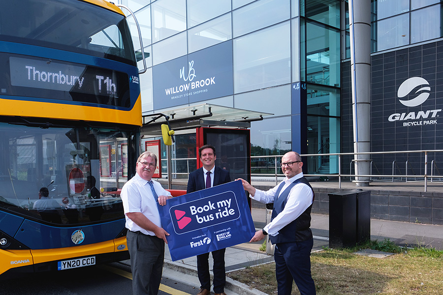 Photo of the 'Book my bus ride' service being launched outside the Willow Brook shopping centre.