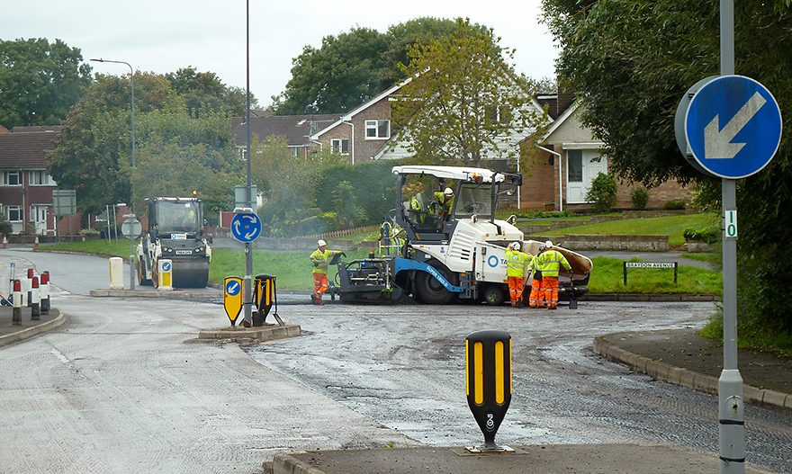 Photo of road resurfacing in progress.