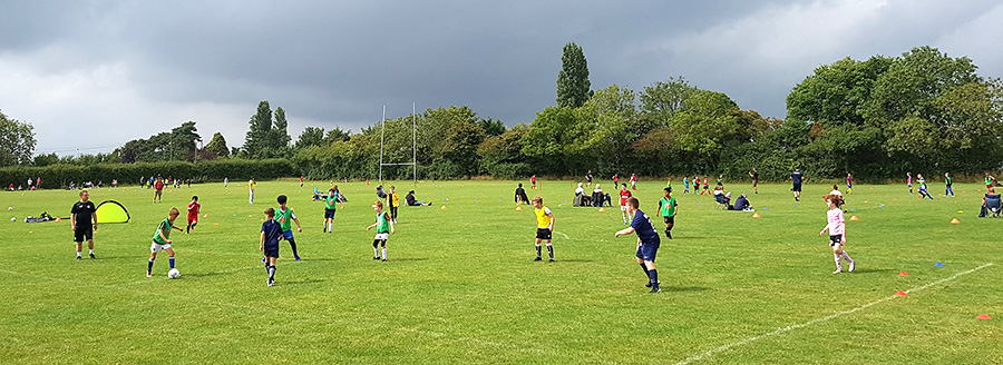 Photo of Bradley Stoke Youth FC teams training at St Mary's RFC ground.