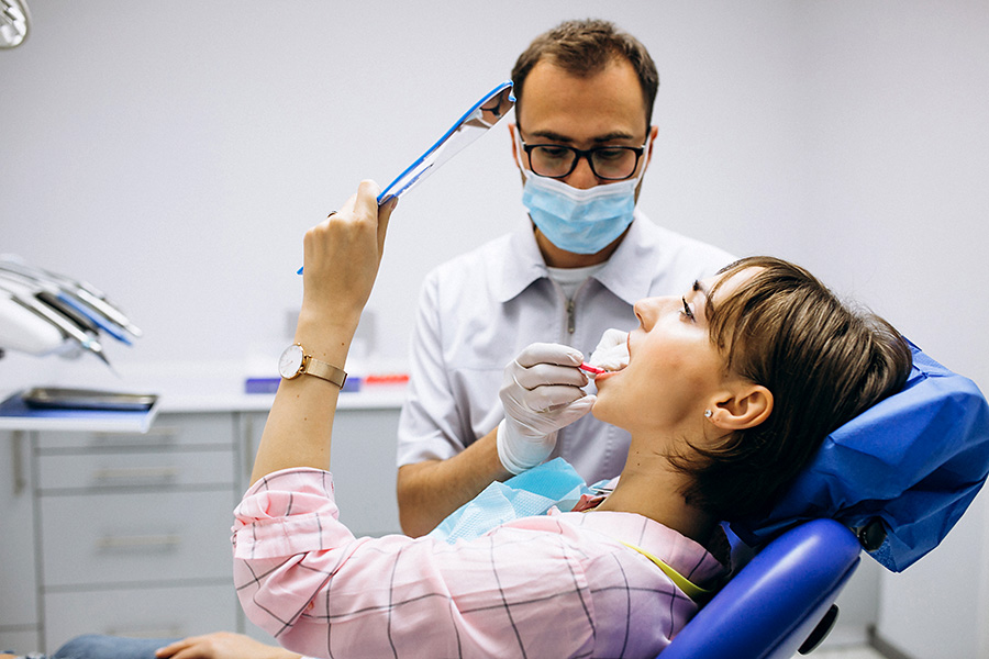Dentist and patient.