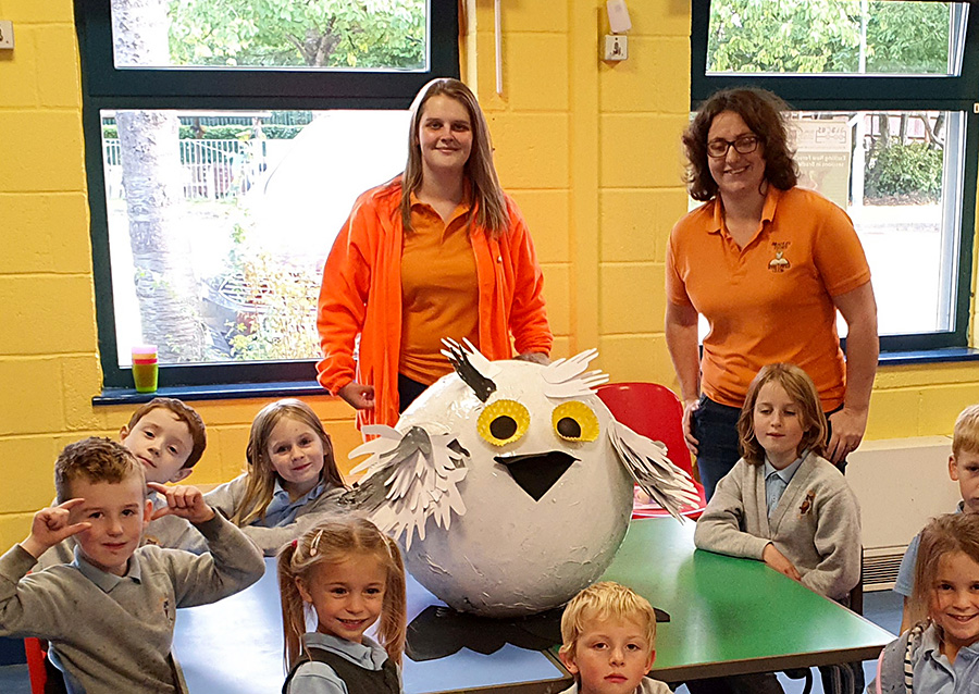 Photo of children and staff at Bradley Stoke Wise Owls Club with their entry for the scarecrow trail.