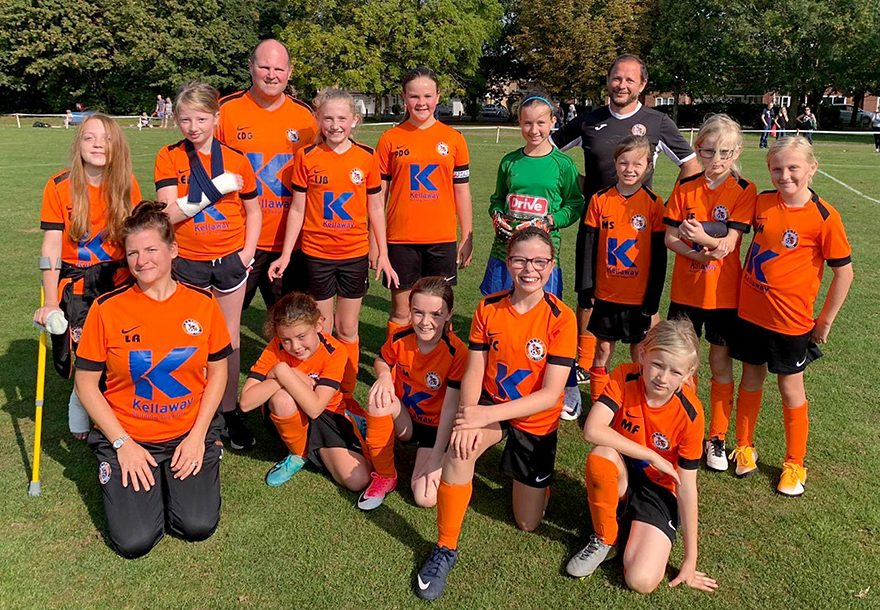 Photo of Bradley Stoke Youth FC Girls players and coaches.