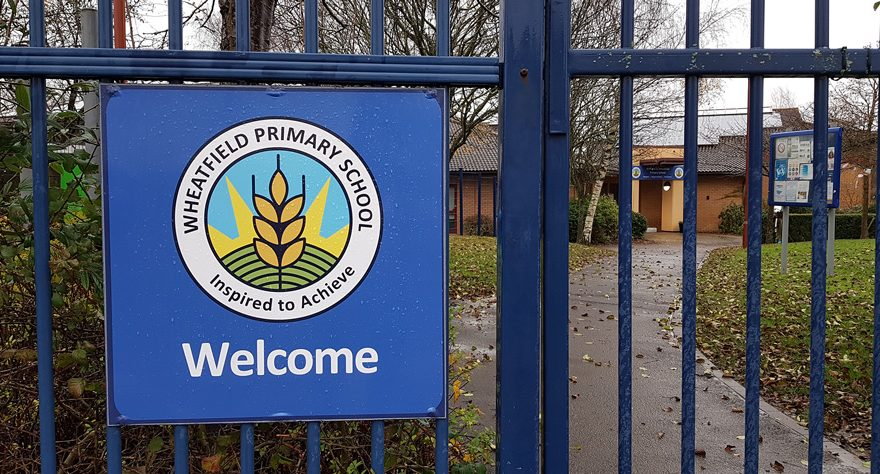 Photo of a closed entrance gate at Wheatfield Primary School.