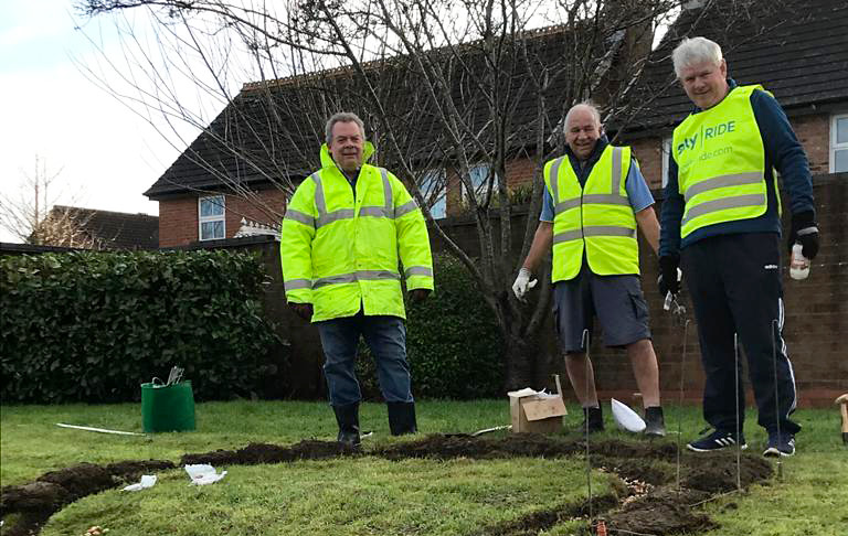 Photo showing members of Bradley Stoke Rotary Club plant crocus bulbs.