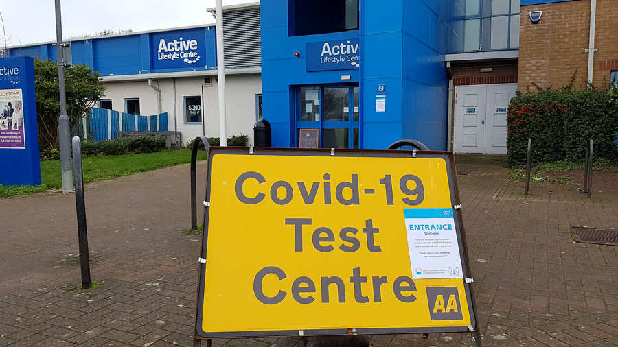 Photo of a yellow 'test centre' sign outside the leisure centre.
