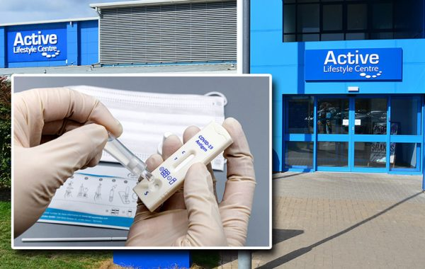 Photo of a Covid-19 lateral test device superimposed on a photo of Bradley Stoke Leisure Centre.