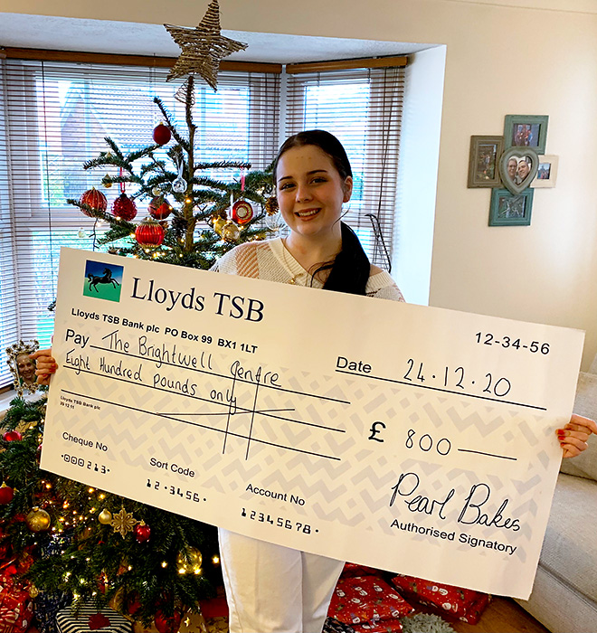 Photo of Pearl Bruford with a presentation cheque.