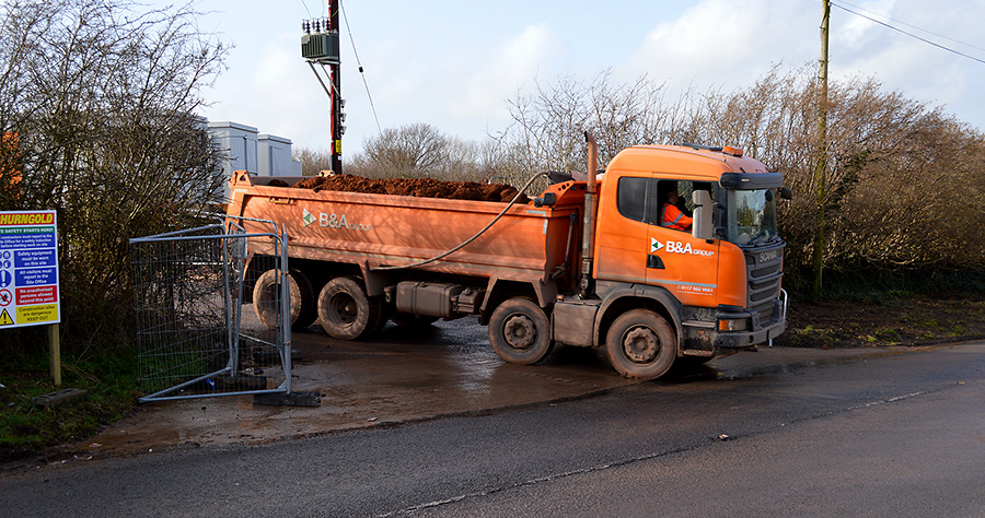 Photo of a tipper truck emerges onto Old Gloucester Road.
