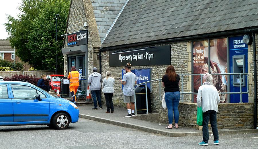 Photo of a socially distanced customer queue.
