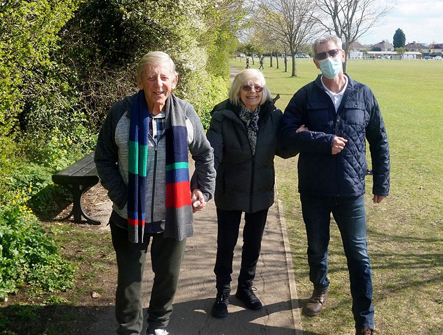 Photo of Joan Osmond walking in the park.