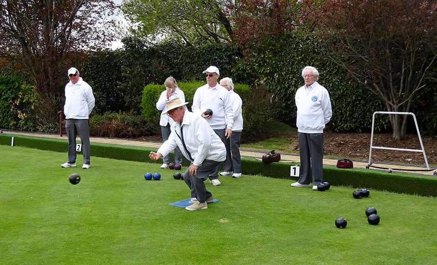 Photo of bowlers on a green.