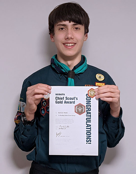 Photo of a Scout holding a certificate.