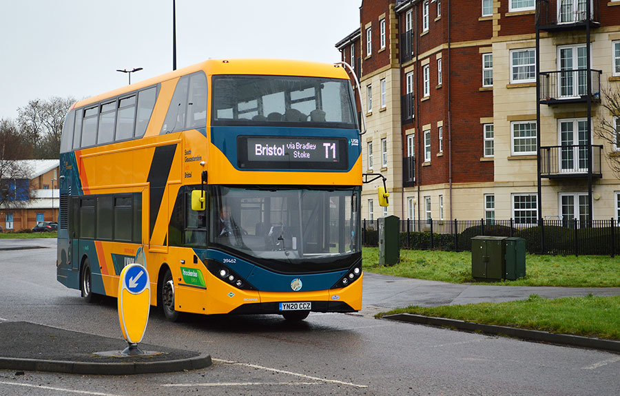 Photo of a yellow double-decker bus.