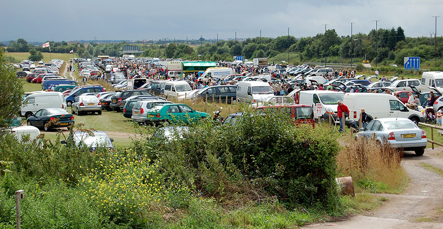 Photo of a large car boot sale in progress.