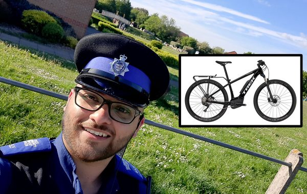 Photo of a PCSO with an image of an electric bike overlaid.