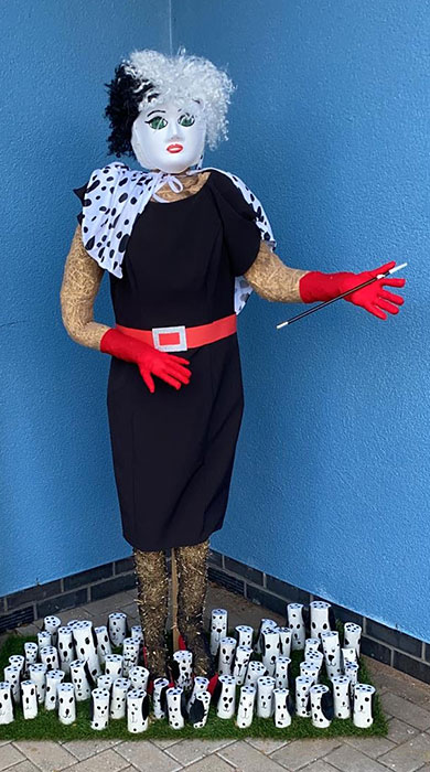 Photo of a scarecrow in the form of animation film character Cruella de Vil.