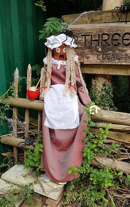 Photo of a scarecrow.
