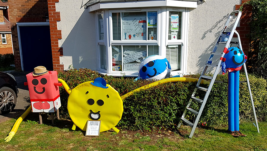 Photo of four scarecrows in the form of Mr Men characters.