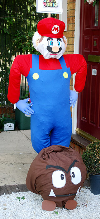 Photo of a scarecrow in the form of Super Mario.